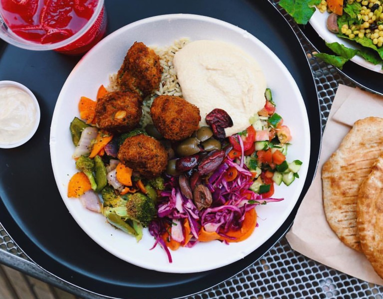 basmati and wild rice bowl with ALL the rainbow salad fixings • raw tomato and cucumber salad, red cabbage slaw, hummus, olives & crispy falafel + piping warm pita // inmybowl.com